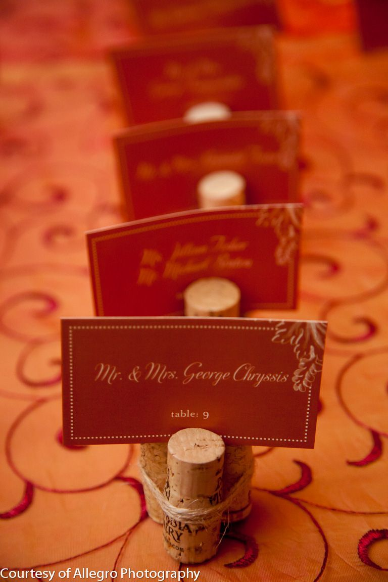 Wine corks as fun place card holders. Photographed by ...