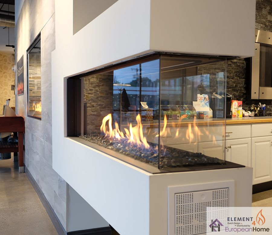 The Lucius 140 By Element4 And Distributed By European Home Is A Stunning Frameless Peninsula Fireplace Featuring Modern Fireplace Fireplace Glass Fireplace