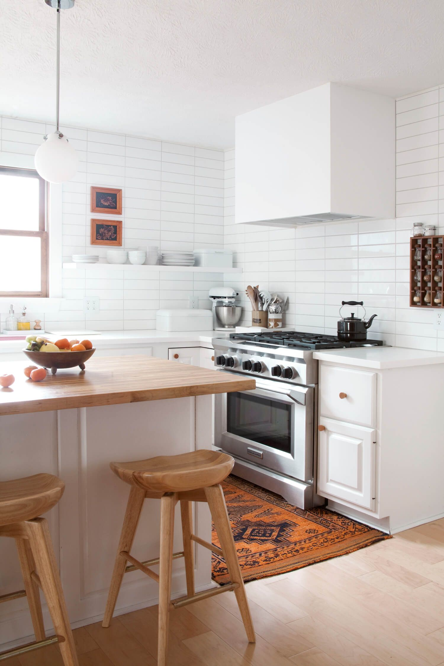 renovated kitchen honest beams what we loved this week in 2018 inspire kitchens pinterest inside a light filled that includes white tiles open shelving and bubblegum pink sink