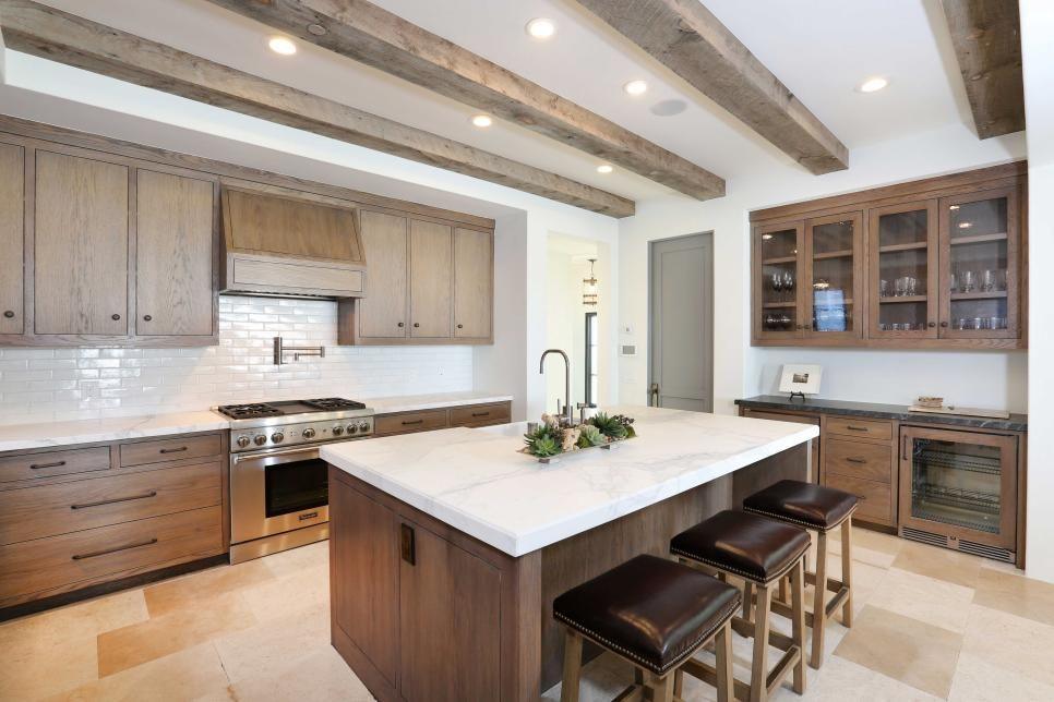 White oak cabinetry exposed wood beams and white stone - Modern rustic kitchen cabinets ...