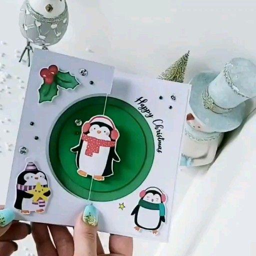 A cute Christmas penguin spinner card