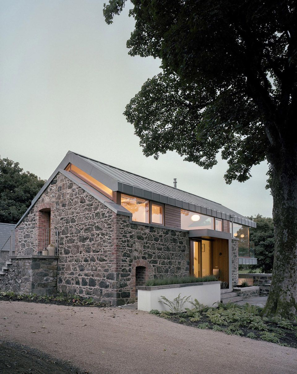 A Small Home Built Around An Existing Stone Barn Structure