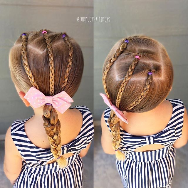 """I started with 3 diagonal topsy flips and braided the """"tails,"""" then I pulled everything into a low left pony. I finished with a regular braid but I braided 1 of the 3 strands for a fun accent!  This cute bow is from @picklesandco_bows!"""