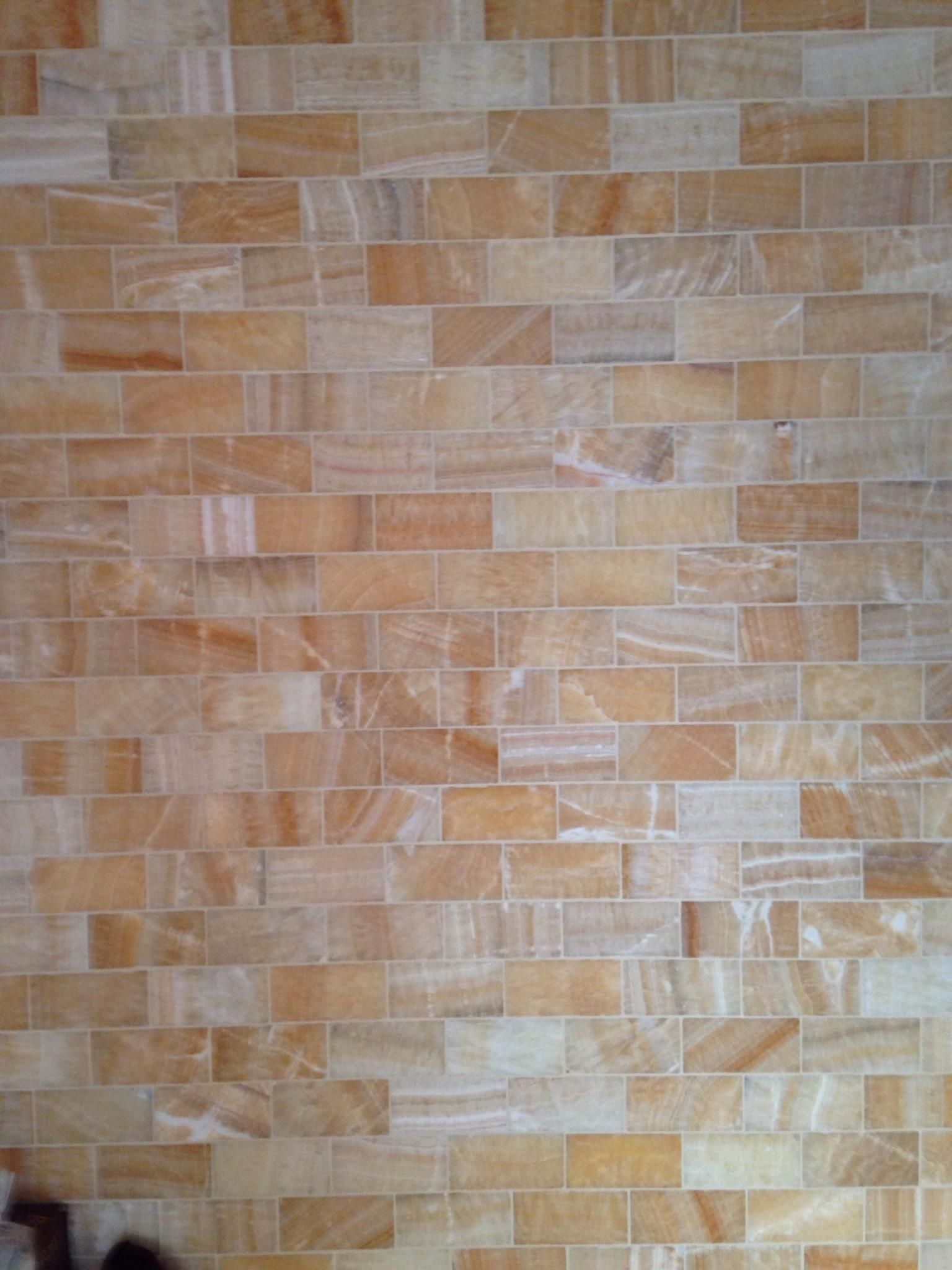 Honey Onyx Subway Tile On A Shower Wall Can Brighten Up A Dark