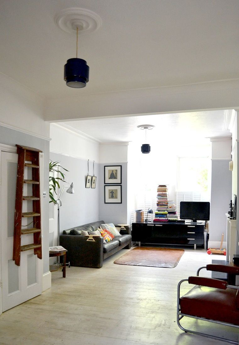 Living room with light blue-grey paint below picture rail and white ...