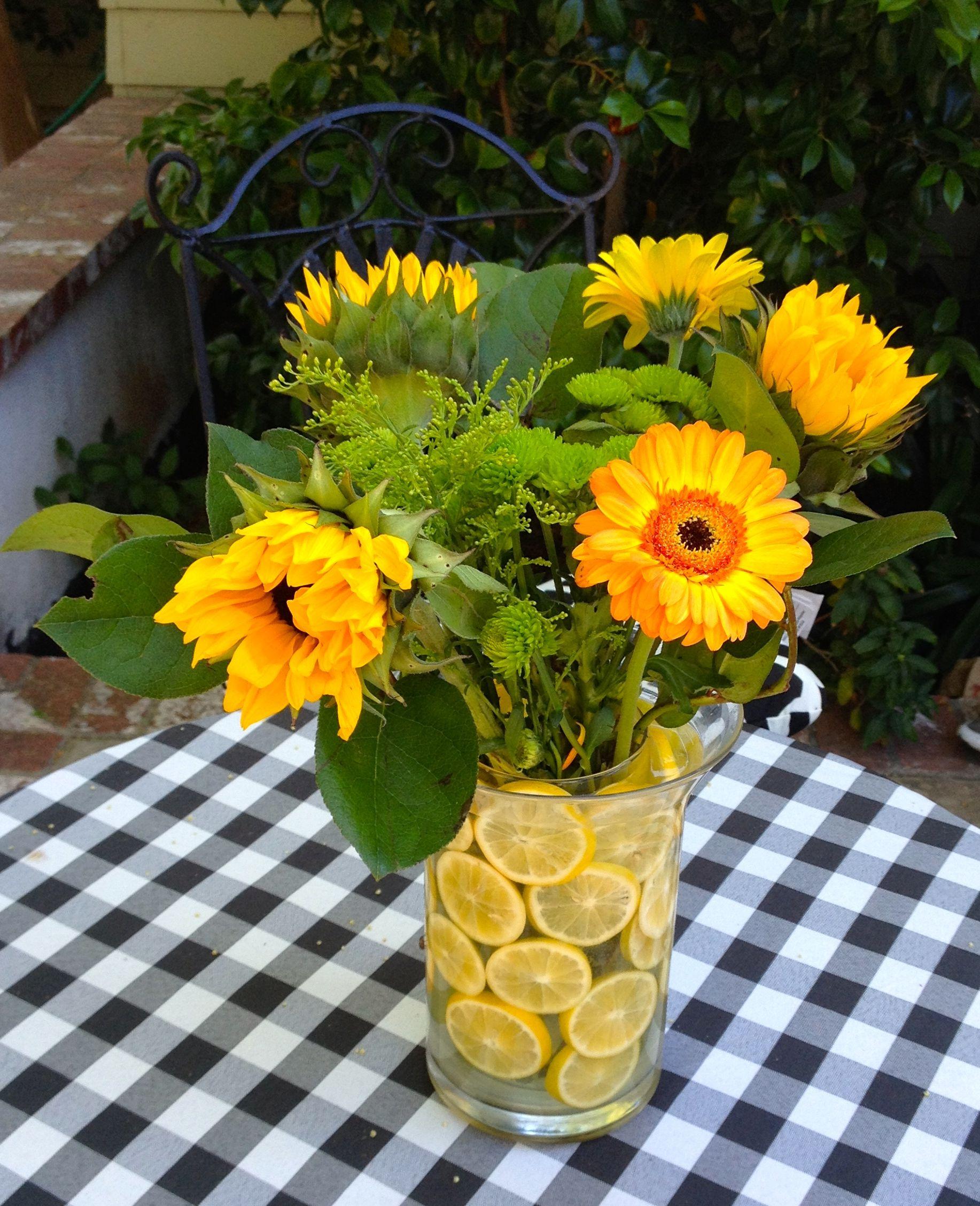 Summer centerpiece sunflowers gerber daisies lemons