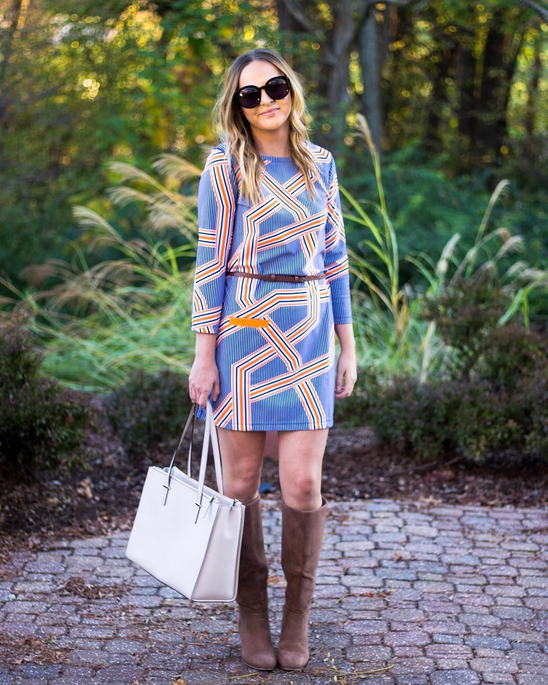 We are loving how @ashncarrington styled this shift  dress 🍂🍃🍁. Add a belt & boots for a whole fall look.  #cabanalife #dress #fall