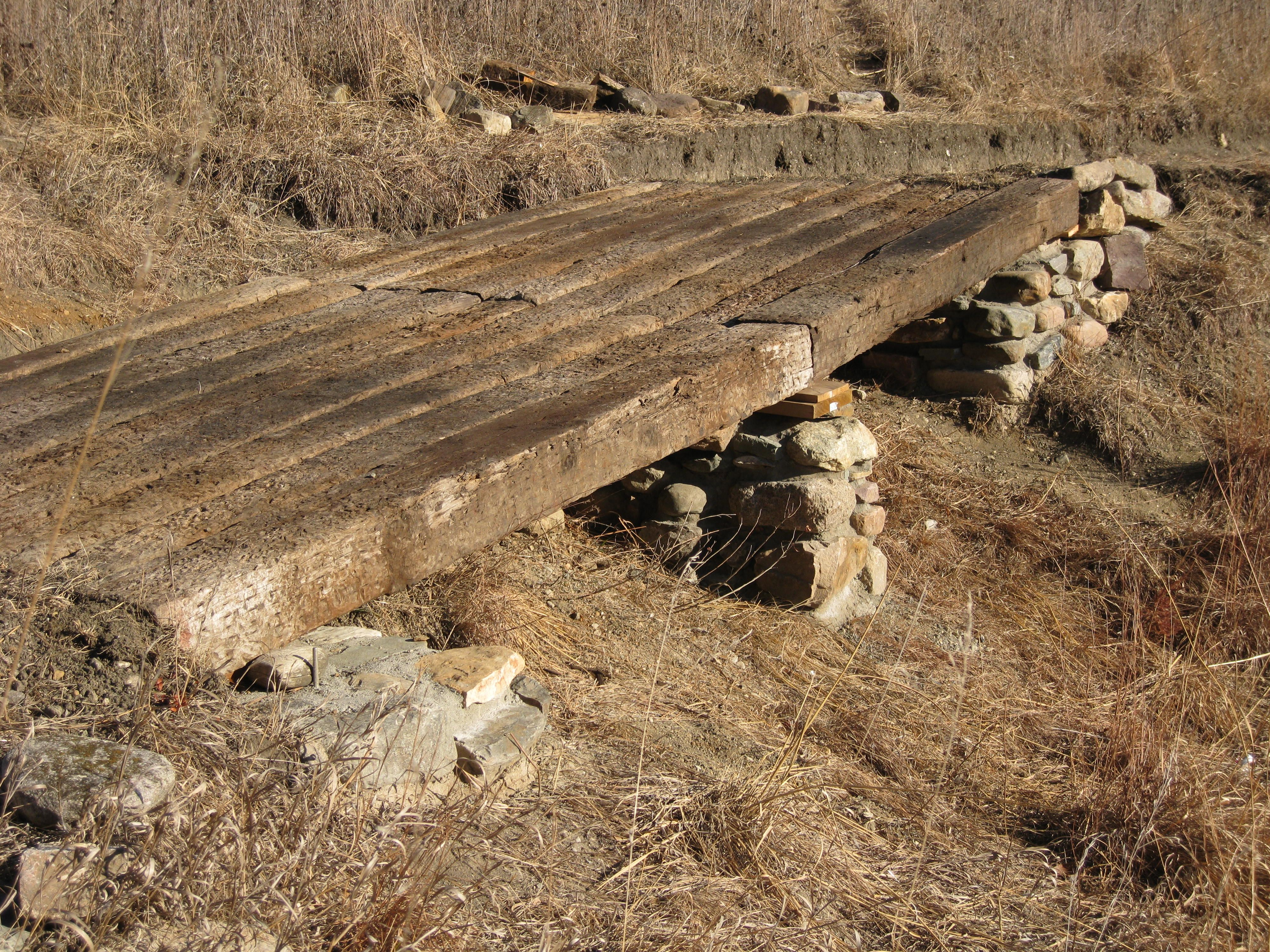 Field stone and railroad tie foot bridge   Landscaping with stone ...