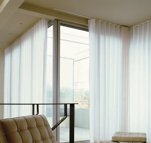 Sheer Ripple Fold Curtain On A White Curtain Track Curtains
