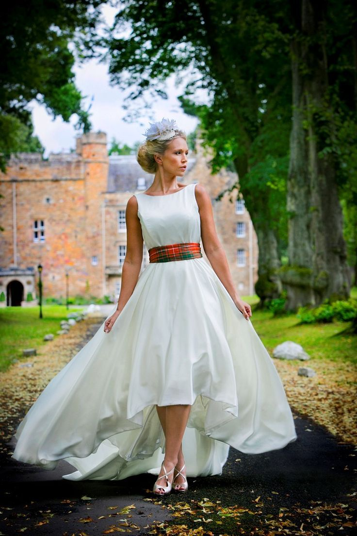 Scottish bride with castle in the background notice her for All white wedding dress