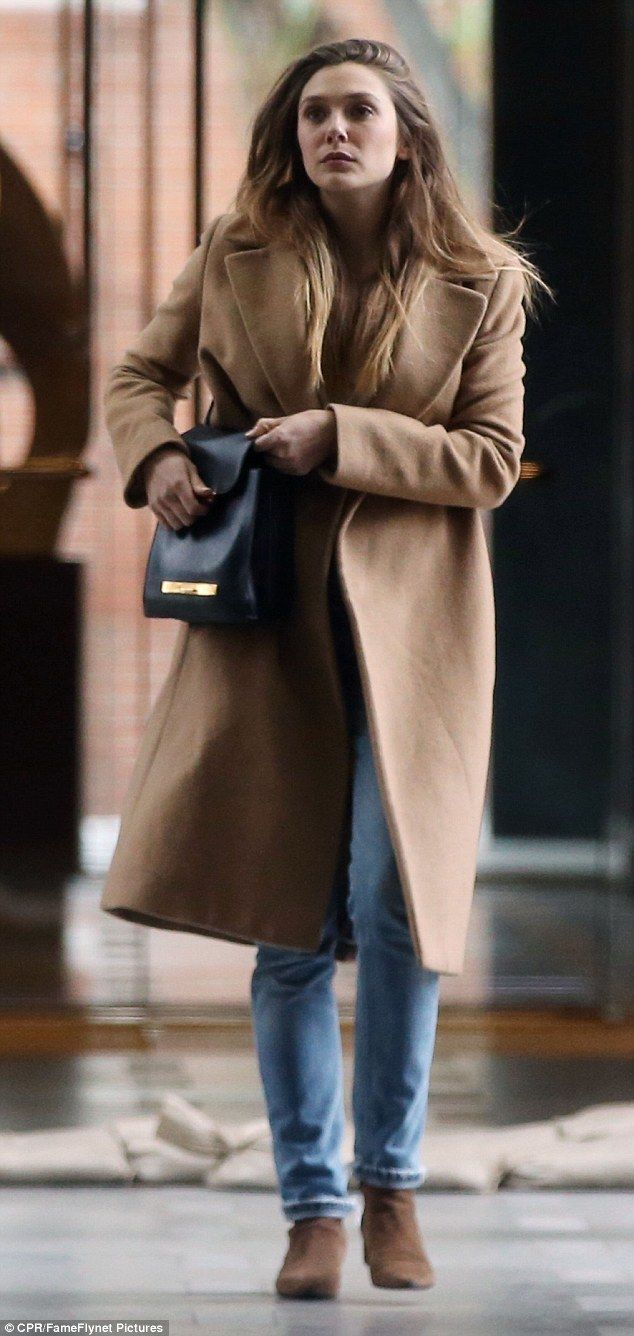 Pretty: The actress, 28, stepped out in a long camel coat that complemented her fair color...