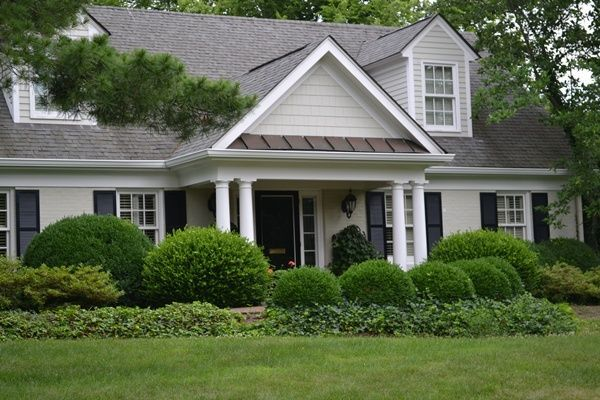 Best Bone Painted House With Black Shutters And Planting In 400 x 300