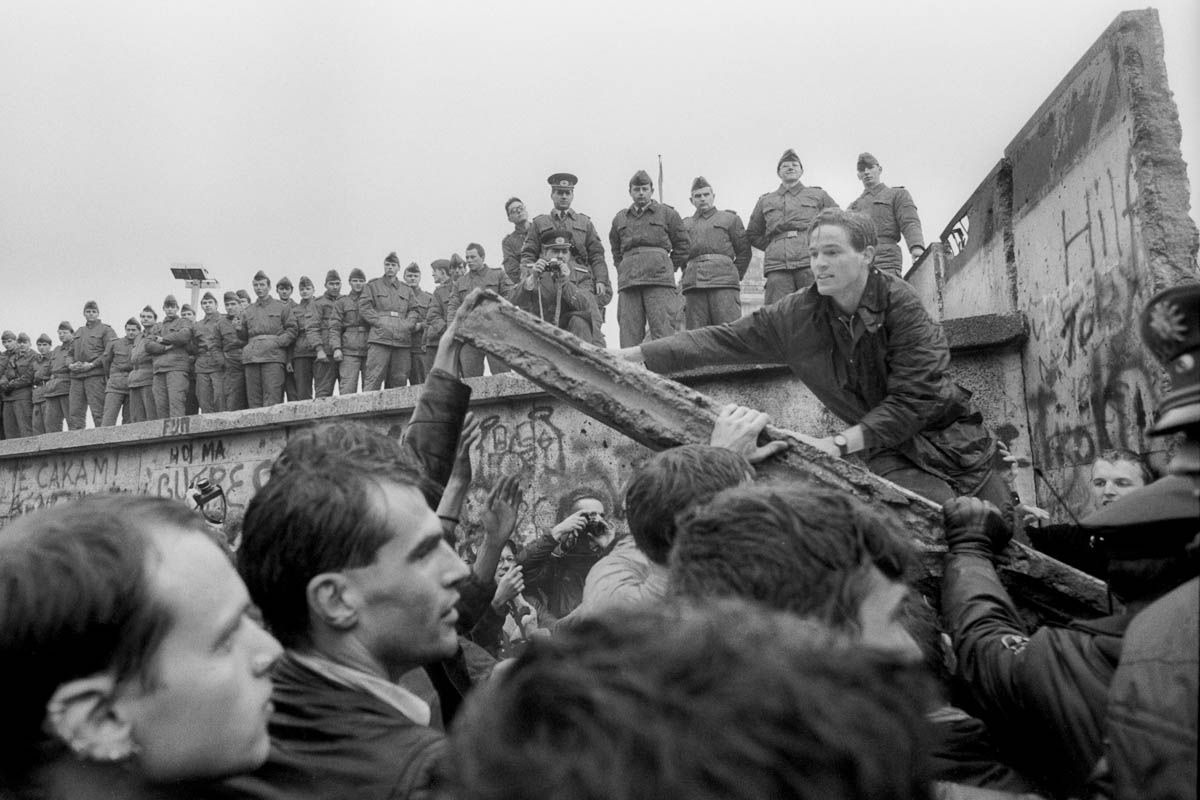 Protesters tear down the Berlin Wall as East German police watch, 1989