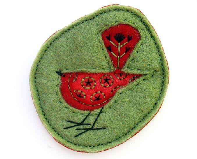 uccellino rosso spilla