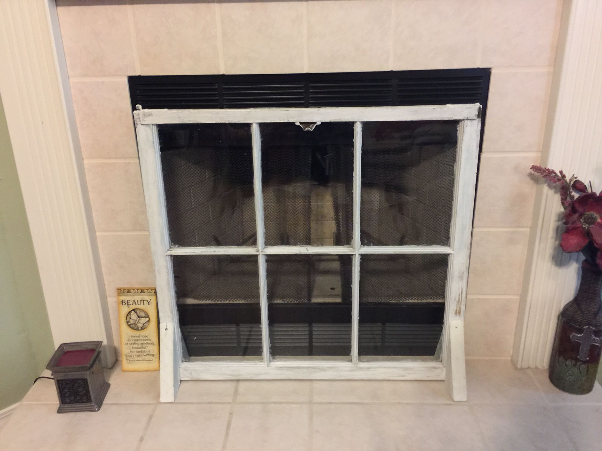 DIY fireplace cover made from an old window.