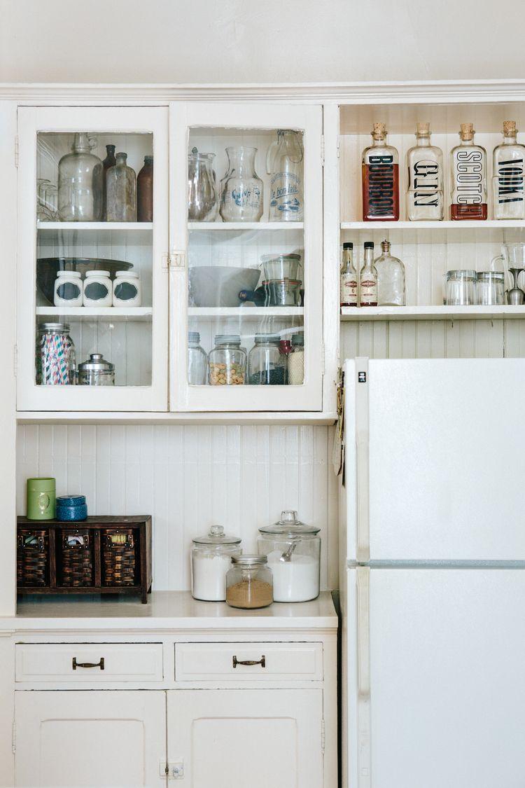 Lovely kitchen storage - love those liquor bottles!