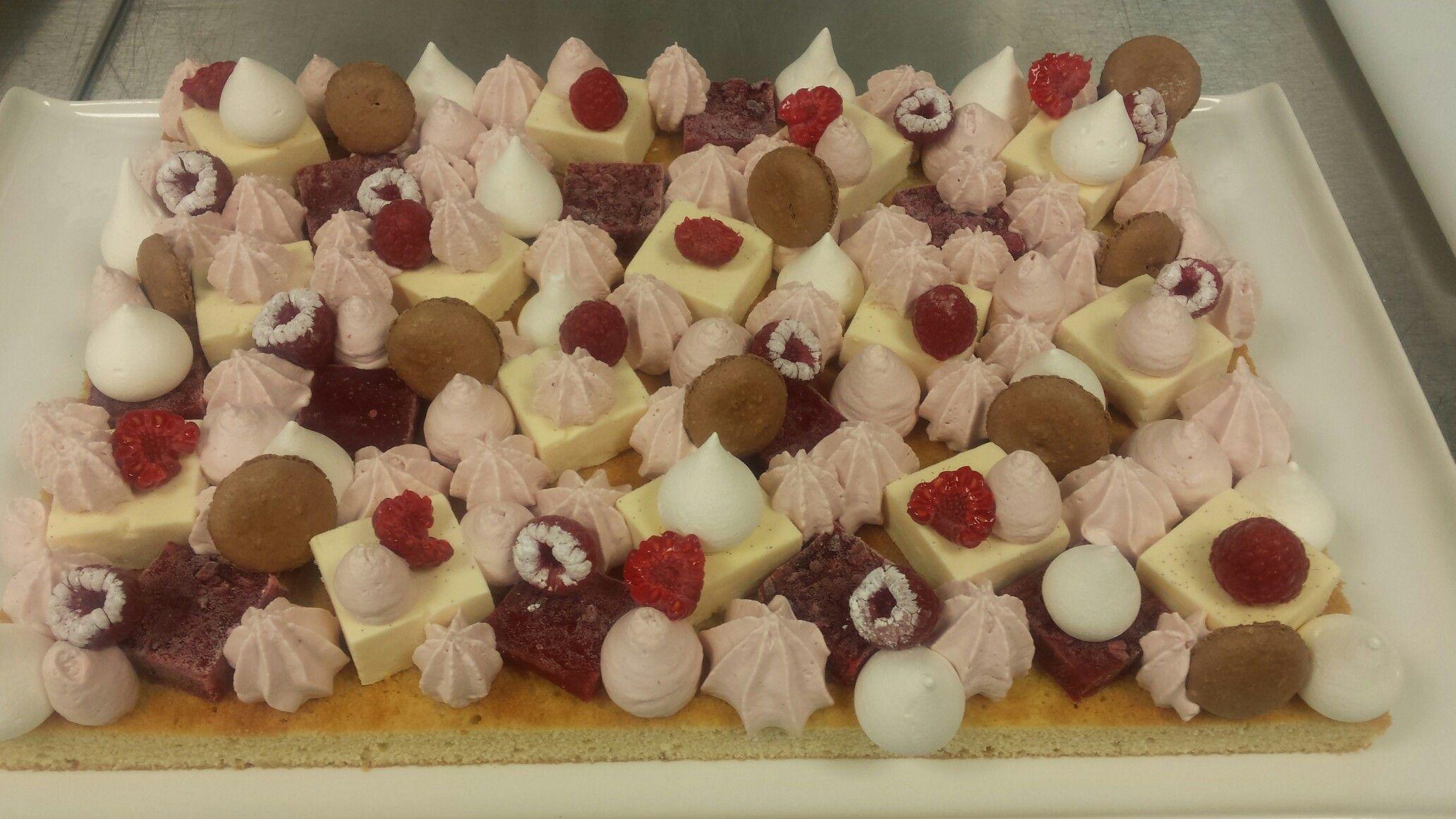 Vanilla sponge and mousse/ raspberry jelly and mousse/ cocoa macaron/ vanilla meringue