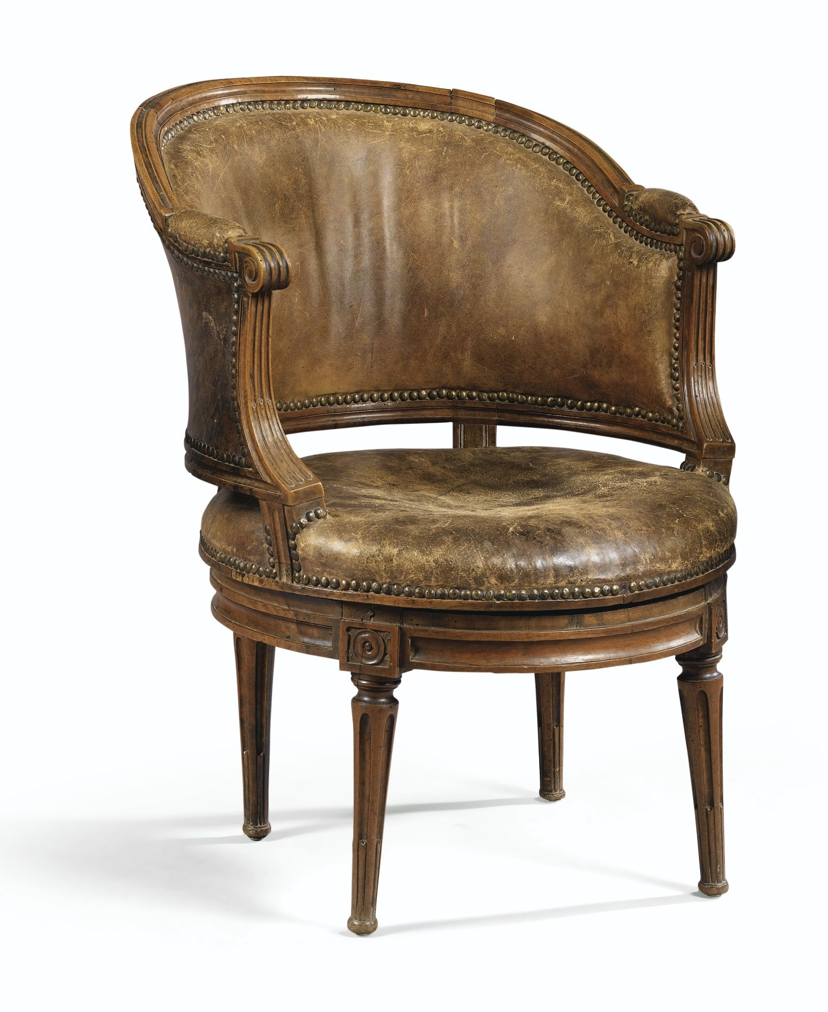 fauteuil de bureau assise tournante en h tre naturel sculpt d 39 poque louis xvi sotheby 39 s. Black Bedroom Furniture Sets. Home Design Ideas