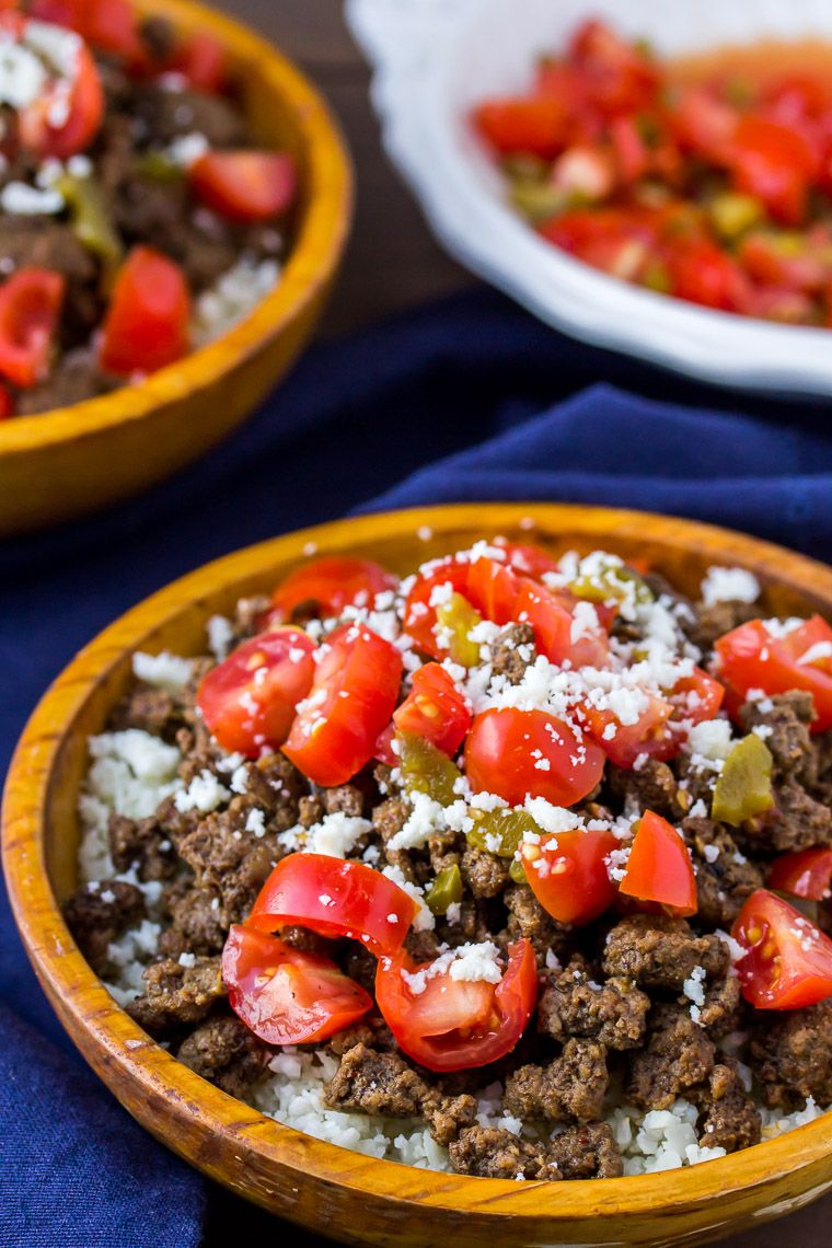 2 keto mexican beef bowls in orange wood bowls with salsa