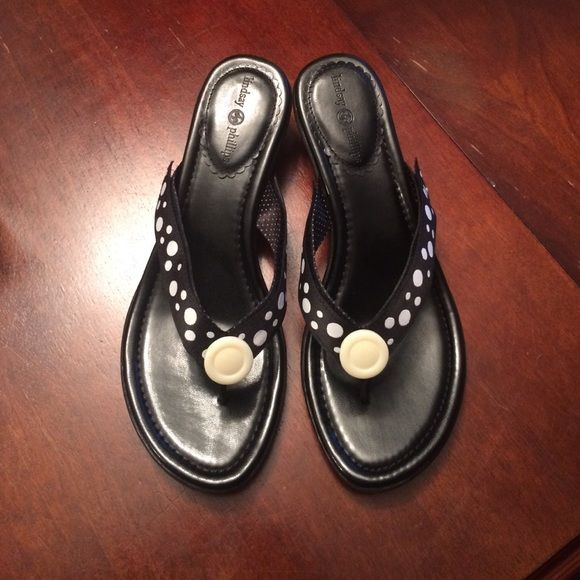 "Lindsay Phillips switch flop sandal Fun flip flops! You can switch out the straps with other straps for different colors or designs. Comes only with the one strap on the heel. They are a black sandal with about a 1"" heel. In great condition! Lindsay Phillips  Shoes Sandals"