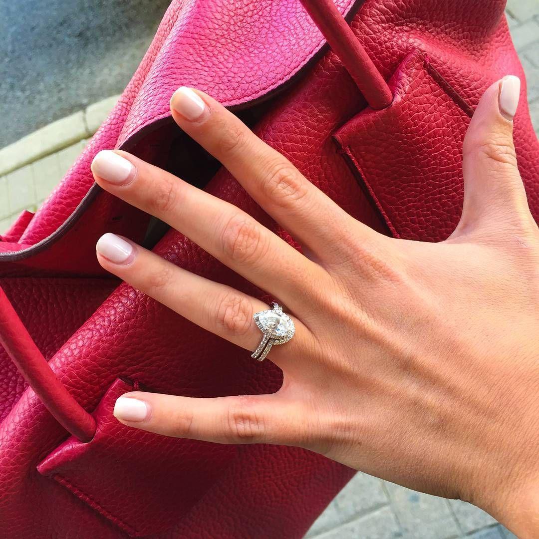 Pear Shape Optic Set Halo Engagement Ring And Matching Wedding Band