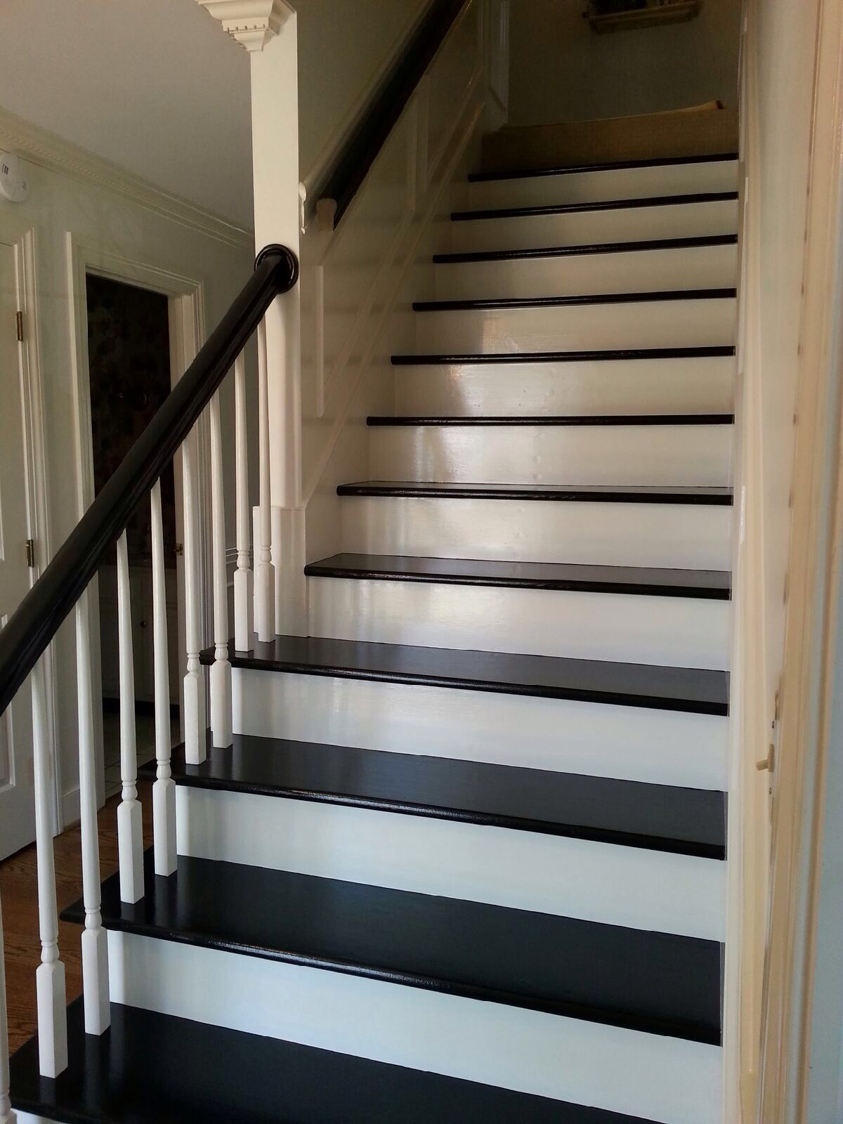 Black Painted Steps And Handrail After Carpet Removal New Entryway