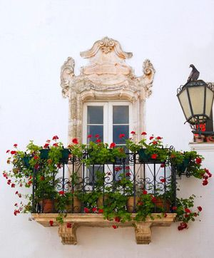 Photo of Milano, Italy  Blank wall with lovely #garden planters on the balcony.
