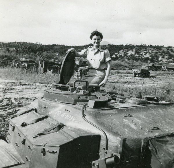 Nesta Bass, part of the Queen Alexandria's Royal Army Nursing Corps, sits on top of a tank in Korea.
