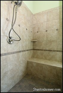 this green master bathroom shower incorporates four styles of tile