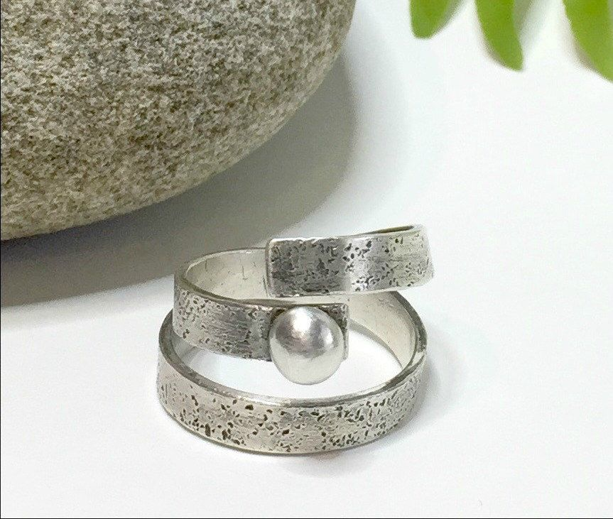 A personal favorite from my Etsy shop https://www.etsy.com/listing/468459750/signature-wrap-ring-sterling-silver-wrap