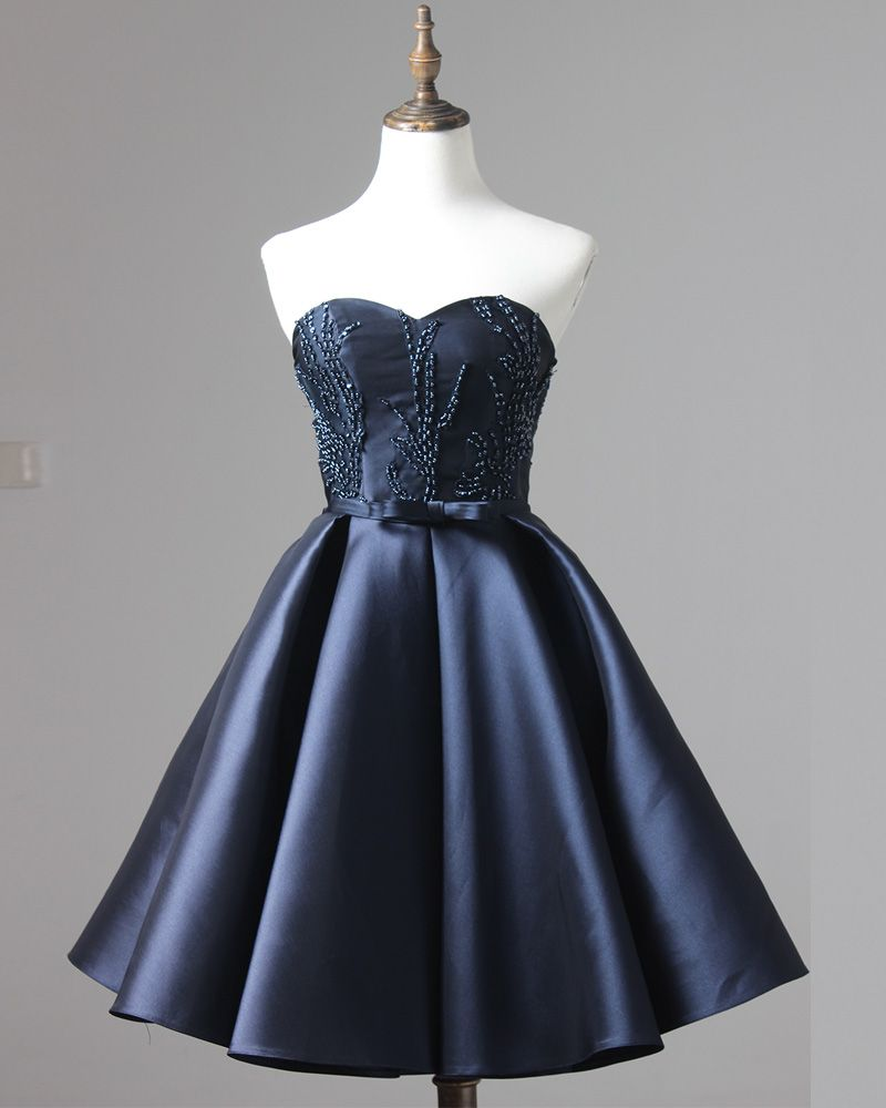 Satin navy blue short homecoming dress featuring beaded sweetheart