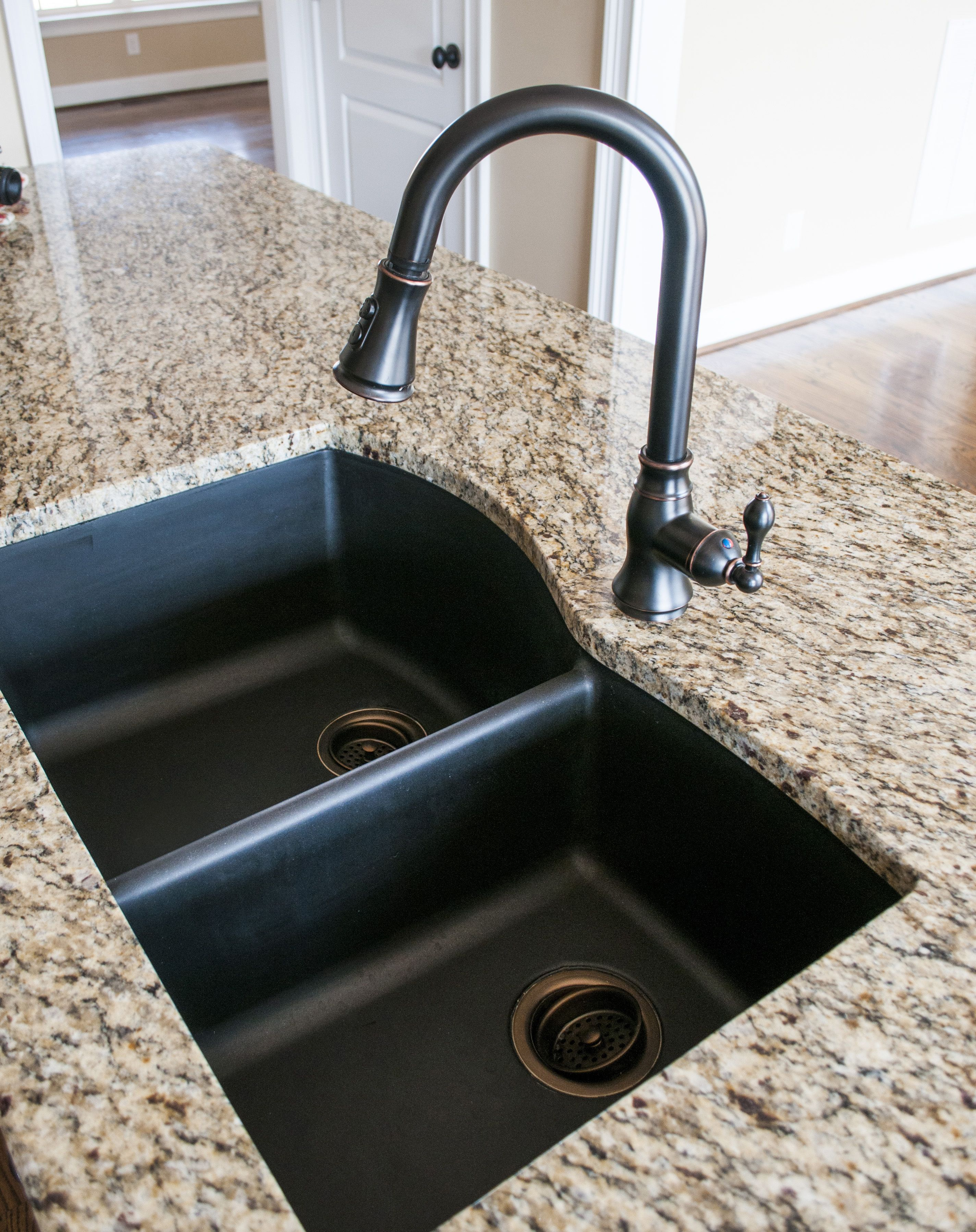 Black granite composite sink with Kohler Oil Rubbed Bronze faucet ...
