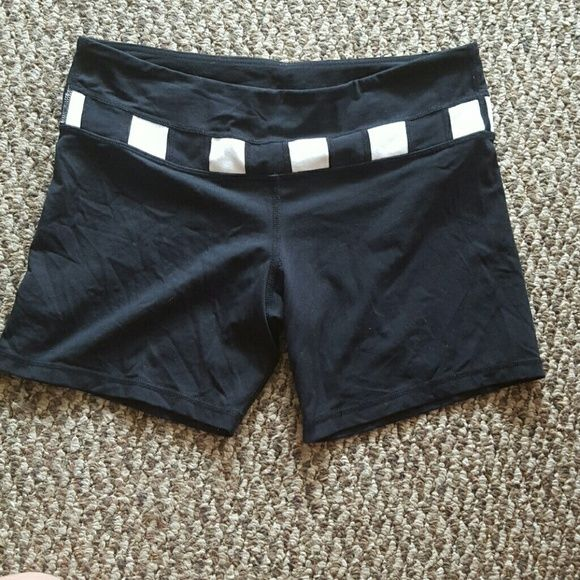 Black lululemon shorts Black lululemon shorts with black and white band. Spandex and super stretchy. Reposhing these because they are a bit longer than I would like and a little too sheer. Excellent condition size 10 lululemon athletica Shorts