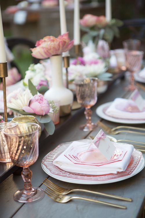 Pretty outdoor table setting for a pink wedding // Via Poppy and Plum.