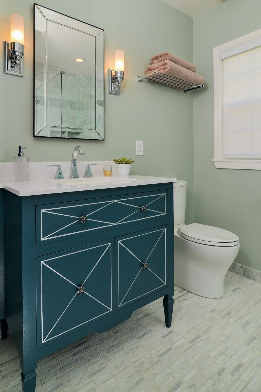 This contemporary bathroom space features metallic bathroom sconces ...