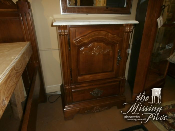 Cute vintage marble top nightstand with beautiful wood carvings.  Measures 24*17*33. Matching pieces at time of posting.   Arrived: Friday December 16th, 2016