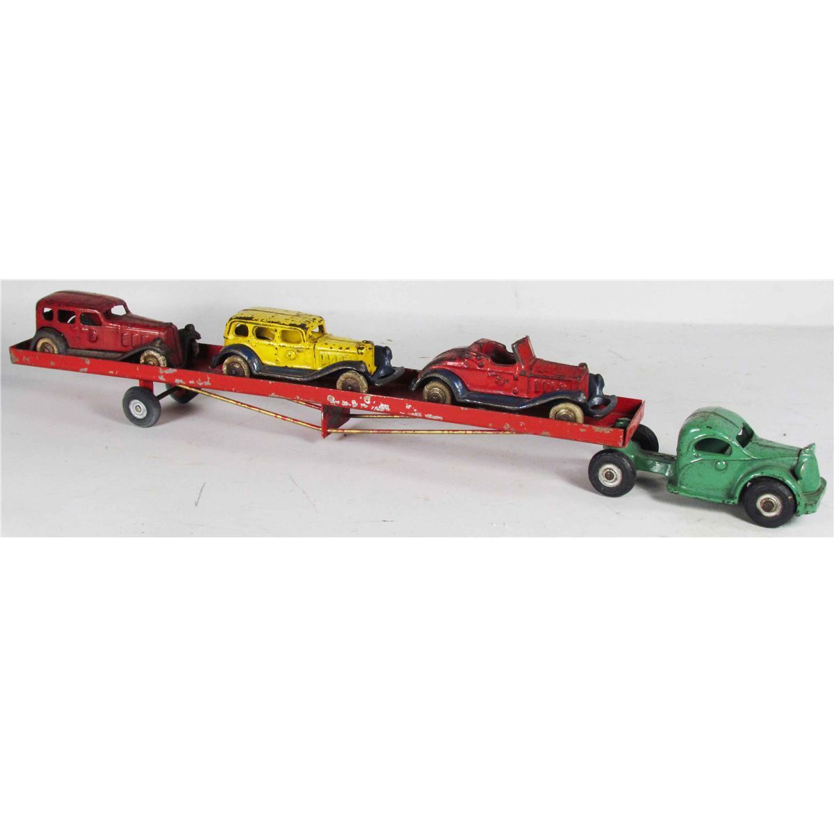 Arcade toy co cast iron car hauler green cab with red