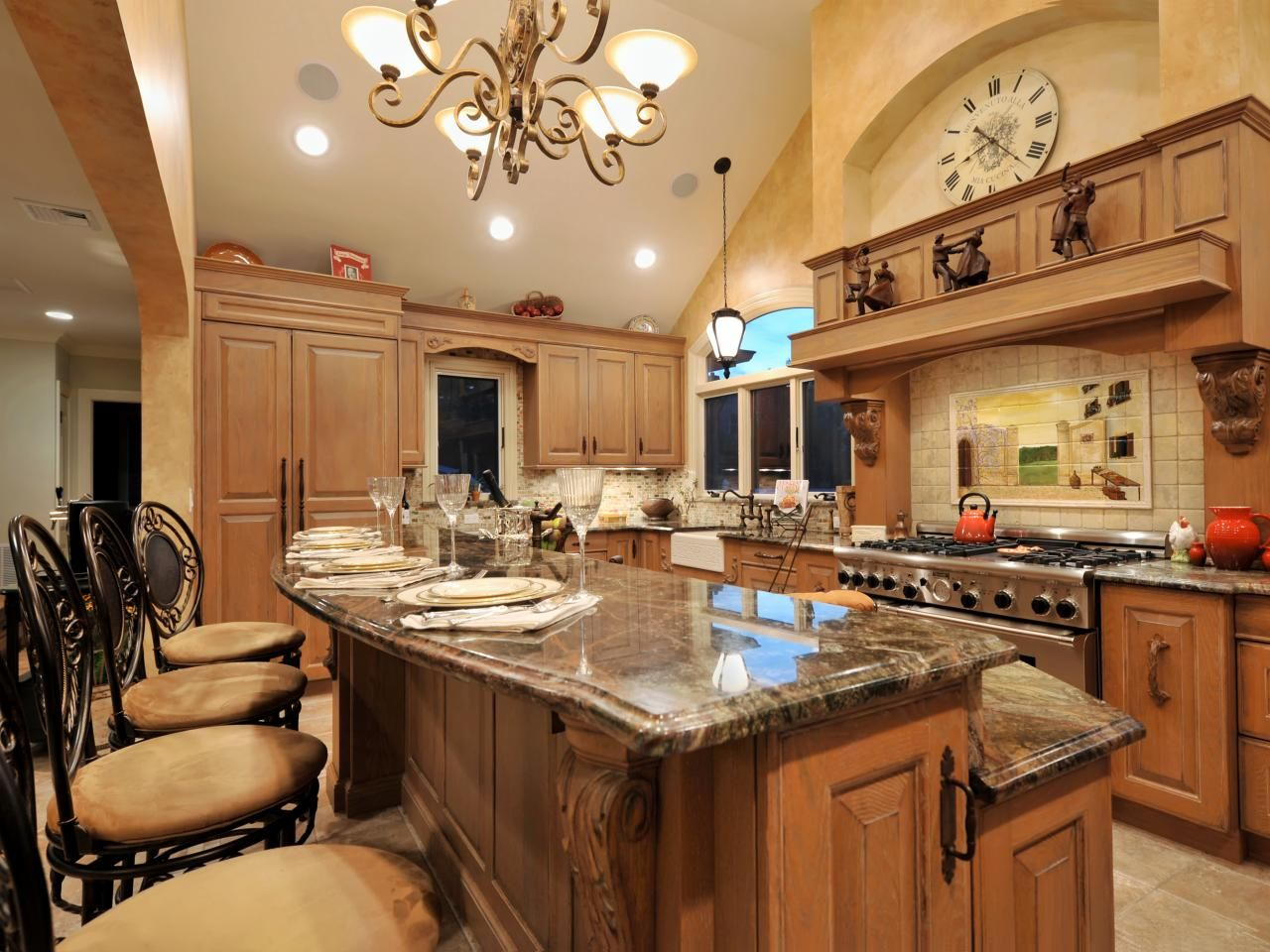 A twotiered kitchen island with granite countertops provides bar