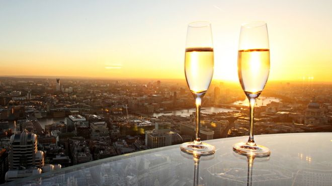 Vertigo 42 - 42nd floor, expensive, amazing views, min £10 spend per head, reservation needed, date, special drinks