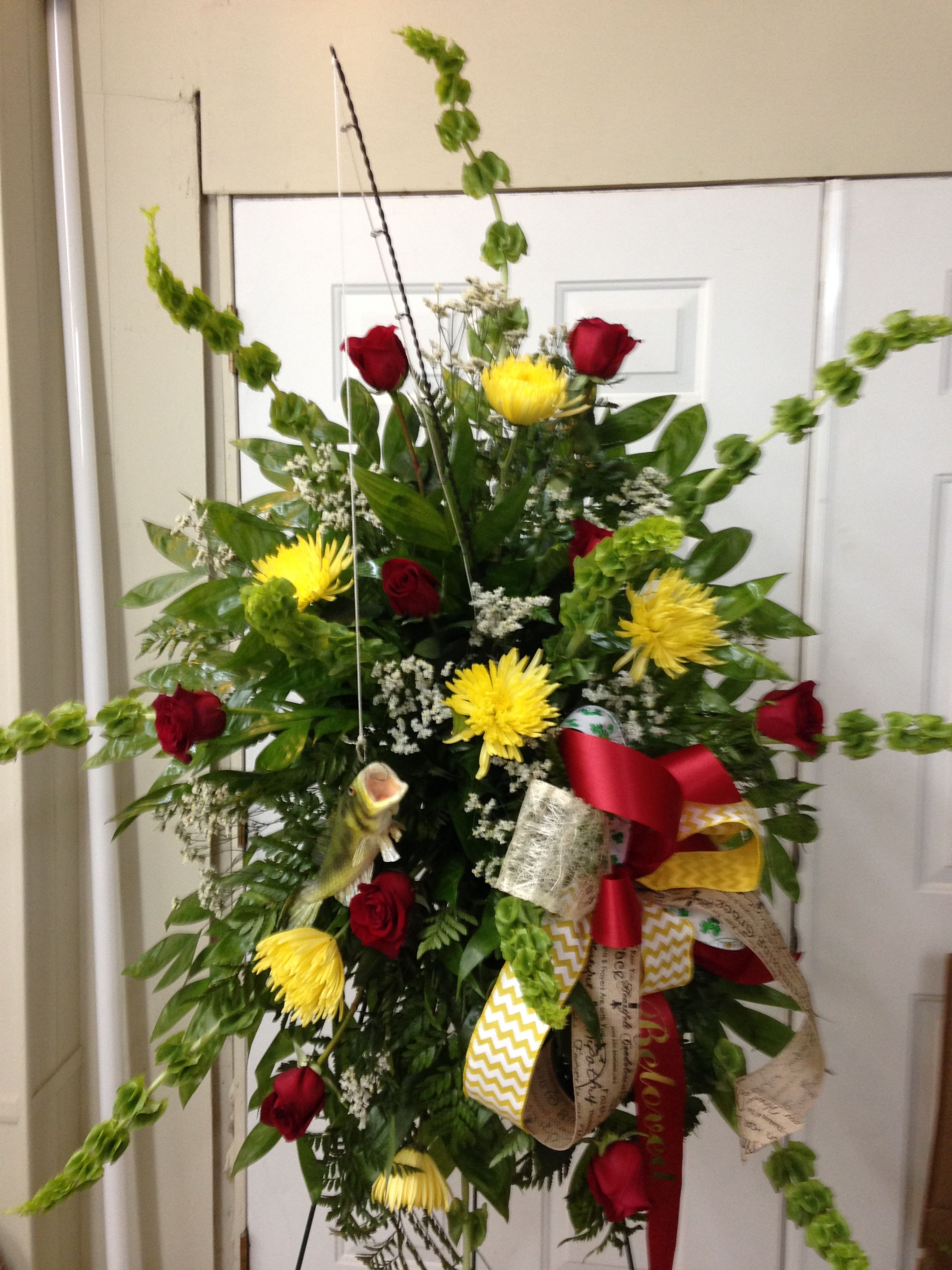 Fresh funeral spray using bells of ireland yellow fuji mums red fresh funeral spray using bells of ireland yellow fuji mums red roses white filler with multiple colored and prints bow also has fishing rod and a fish izmirmasajfo Gallery