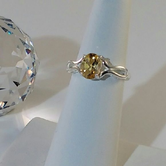 Genuine Citrine Gemstone Ring Gorgeous golden yellow oval cut citrine semi-precious gemstone measures 6x8 mm. This genuine citrine solitaire exhibits excellent clarity and is beautifully faceted. This alluring citrine gemstone is set on a size 6 solid sterling silver ring. See gemstone details in this listing. New. Jewelry Rings