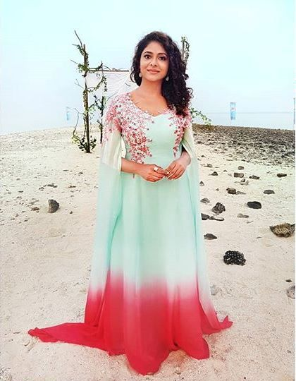 9248fd758fe Poornima Indrajith in Pastel blue and watermelon red cape gown detailed  with floral hand embroidery.  pranaah