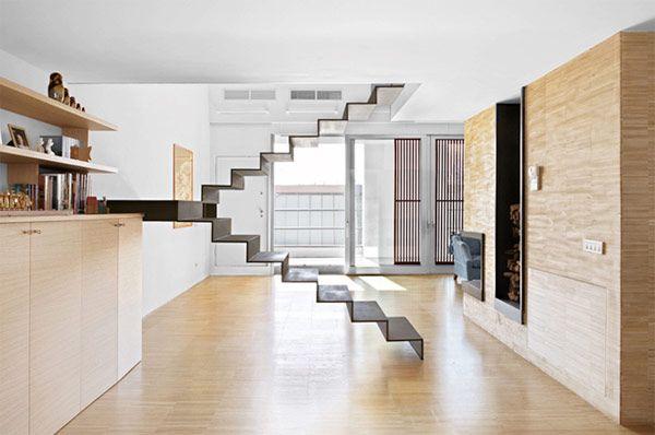 Deze minimalistische trap is een blikvanger in je woonkamer
