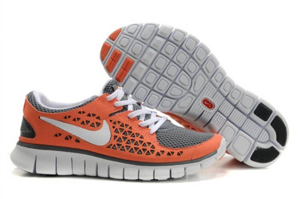 buy online 9cccf dd039 Womens Nike Free Run Orange Grey White Shoes