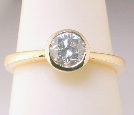 Solitaire 047 carat diamond 18carat yellow gold engagement ring