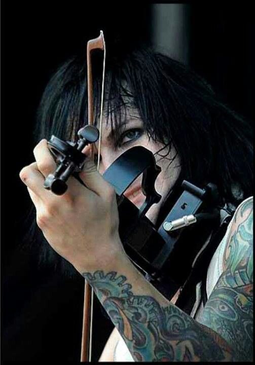 Jinxx playing the violin. He seriously has inspired me to continue playing my own violin no matter what music you listen to such as death metal and post hard core. People like him don't give a damn about their appearance or anything. They just wanna do what they love doing.