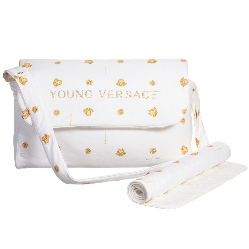 3a587ade24 White fabric baby changing bag by Young Versace that has an all-over gold  Roman