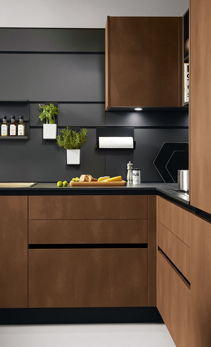 Targa Steel bronze #Schüller #Schullerkitchens #germankitchens #kitchenlighting #modernkitchens #kitchenideas #kitchenstorage #storageideas #cabinets #worktop #splashback #appliances #kitchenappliances #galleykitchen #openkitchen #wallpanelling #wallstorage #kitchentrends #kitchens2018 #handleless #handlelesskitchen