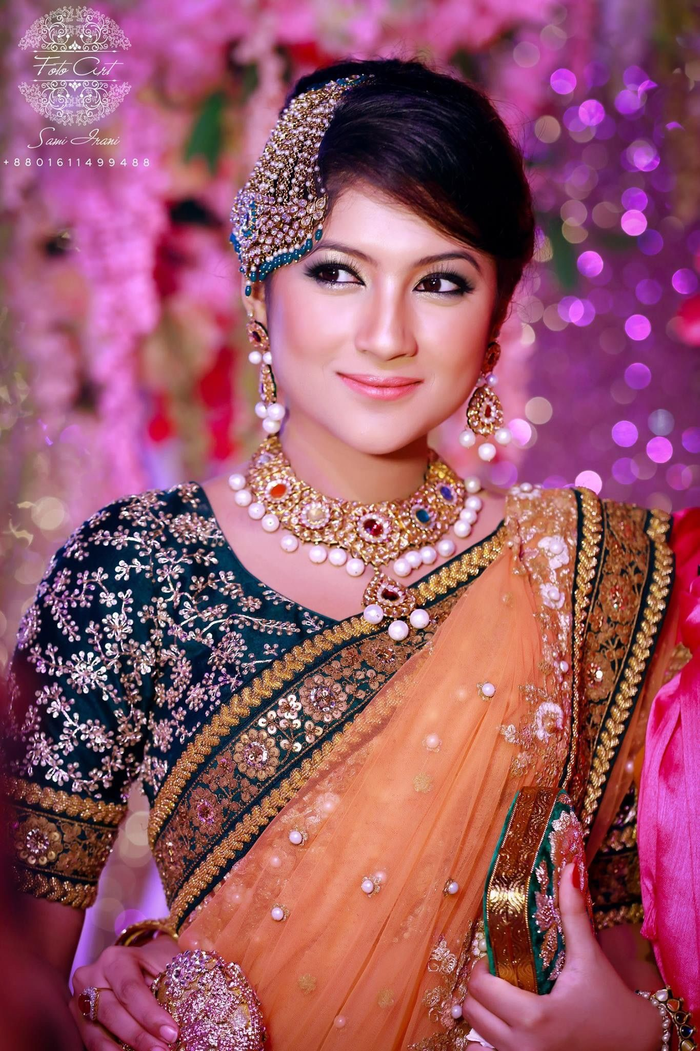 Stunning bride in a traditional Sabyasachi saree, paired up with ...
