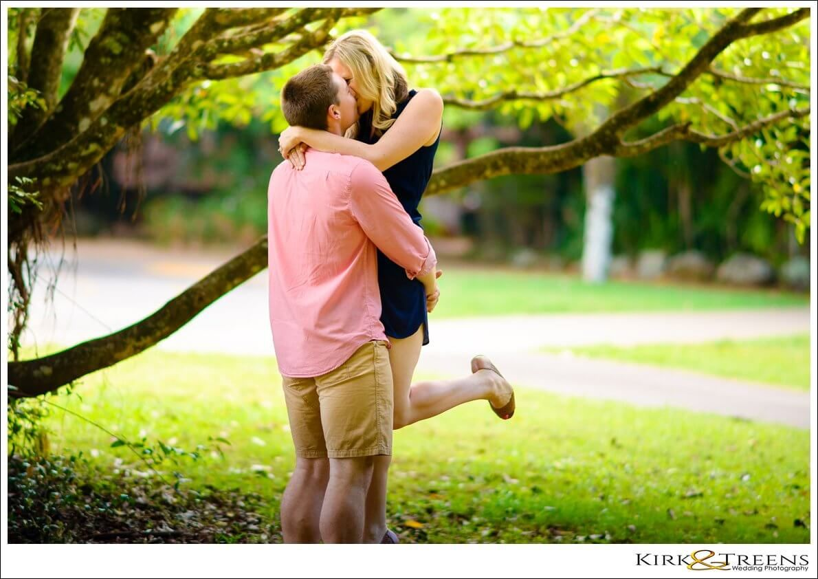 Guy lifting up girl and kissing at Maleny rainforest engagement shoot photo idea | Kirk &